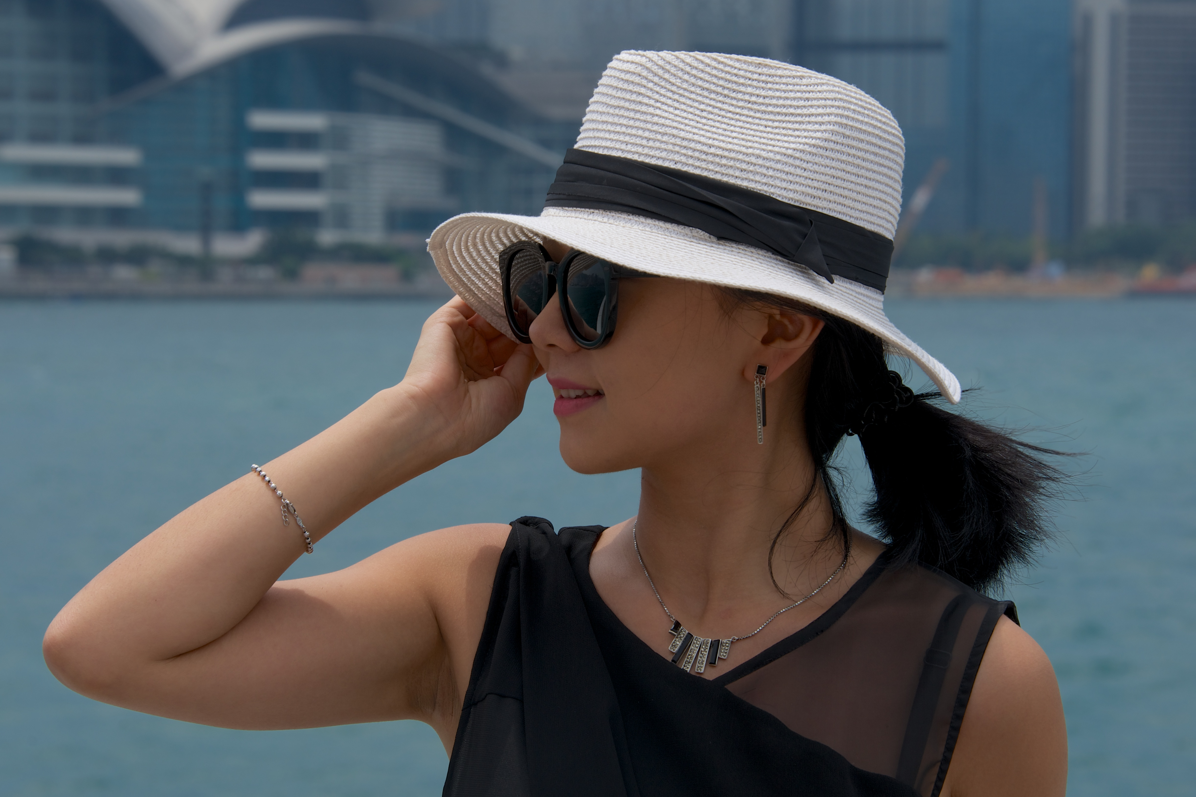 86d66fbc Chinese woman holding Panama hat against wind | Nick Dale